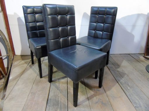 Black button back leather chairs