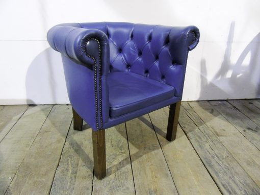 Blue button back tub chair